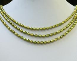 Three Pistachio Green Oval Pearl strands GOGO1068