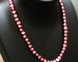 Electric Pink Baroque luster Pearl strand. GOGO 1296