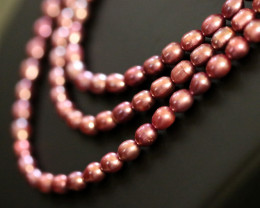 3 Hot Pink / Mauve Oval luster Pearl strand. GOGO 1303