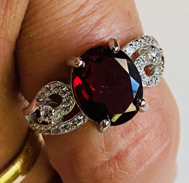on finger garnet is deep red color