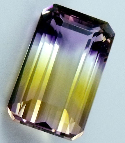 22.1 CTS BI COLOR GEMSTONE (SYNTHETIC AMETRINE)  PG 72