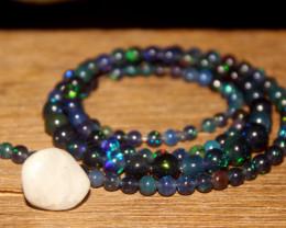 29 Crts Natural Ethiopian Welo Smoked Opal Balls 18