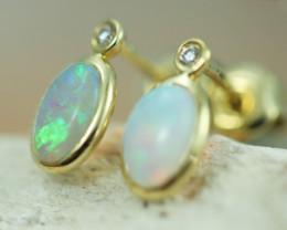 Cute Crystal  Opal set in 14k Yellow Gold Earring CK 500