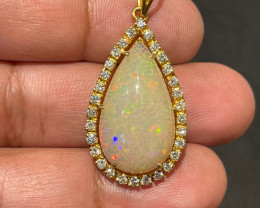 Exceptional Play of Colours in White Welo Opal mounted in Gold pendant acce