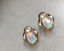 Opal and diamond earrings in 14ct yellow gold