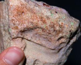 135 grams Andamooka rainbow matrix untreated. [BZ312]