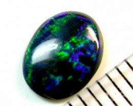DEEP BLUES AND GREEN FLASH FIRE BLACK OPAL STONE .70 CT A201