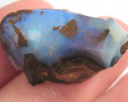 # 33.15 CTS LARGE BOULDER OPAL RUB BLUE FIRE