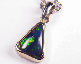 TRIANGLE SHAPED SOLID BLACK OPAL WHITE GOLD PENDANT SCO137