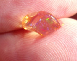 FreeForm carved Fire Mexican Opal 1.67 Carats.