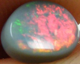 ORANGE AND GREEN ROLLING FIRE  OPAL 0.65 CTS QOM 221