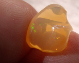 FreeForm carved Fire Mexican Opal 3.0 Carats.