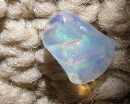 FreeForm carved Fire Mexican Opal 2.80 Carats.