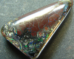 THIS PIECE HAS NICE ELECTRIC GREEN BLUE FIRE RUNNING VERY GOOD THRO THE STONE