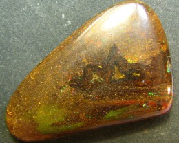 THIS IS A LARGE HIGH POLISHED STONE OPAL HAS NICE TWINKLE FIRE EMBEDED IN THE IRONSTONE NATURAL