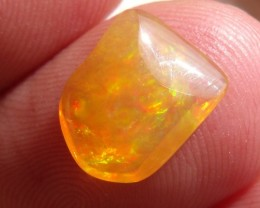 FreeForm carved flash Fire Mexican Opal 2.32 Carats.