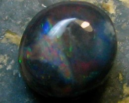 CABOCHON CUT BLACK OPAL N1 BODY TONE AND HAS A NICE FLASH OF RED MUCH MORE THEN PICTURE