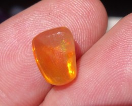 FreeForm  carved flash Fire Mexican Opal 2.17 Carats.