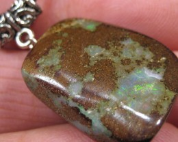 Boulder Matrix Opal Pendant with silver Bail and Leather cord.
