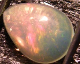 ORANGE FLASH ETHIOPIAN OPAL 1.40 CTS  FOB  17