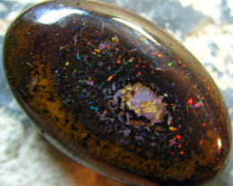 FIRE RED TWINKLE IN THIS NICE LARGE OVAL SHAPE