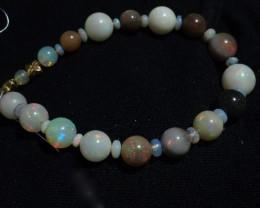 "Gawk at my Opals Welo Opal Round Bracelet 5-11mm 7"" 14k&18k"