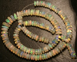 Gawk at my Opals Crystal Wello opal beads. 92.30 carats.