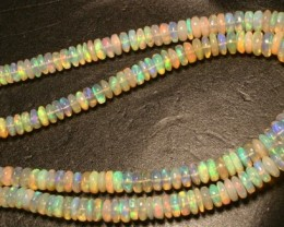 Gawk at my Opals Crystal Welo opal beads. 177 carats.