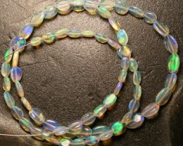 Gawk at my Opals Crystal Wello opal beads. 20.10 carats.