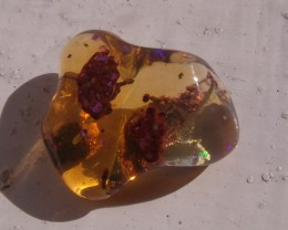 FreeForm carved Fire Mexican Opal 4.20 Carats.