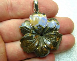 BOULDER FLOWER CARVING MADE INTO A SILVER 925 STAMED PENDANT