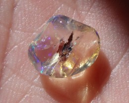 FreeForm carved Fire Mexican Opal 1.64 Carats.