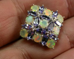 The hand picture gives you a better idea of the fire in the opals-this is how it will look on your finger.