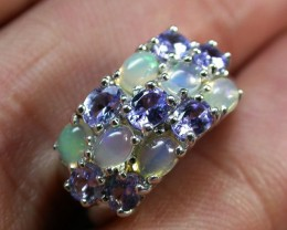 THE HAND SHOT GIVES THE BEST IDEA OF THE FIRE IN THE OPALS