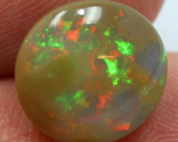 5.85 CTS ETHIOPIAN CABOCHON RED/ORANGE  FIREY STONE A9659