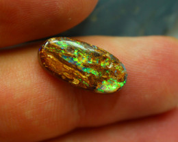 BACK OF THE OPAL HAS GREEN FIRE ALSO