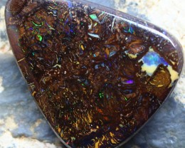 THERE IS PLENTY OF OPAL COLOR FLASH EMBEDDED INTO THE IRONSTONE ,