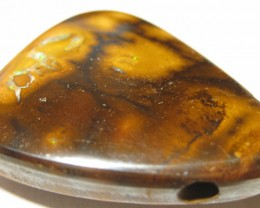 Drilled opal with matrix Patterns.