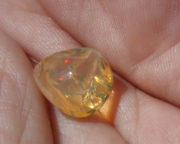 3.94 Carats. FreeForm carved Fire Mexican Opal
