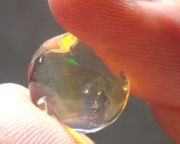 5.14 Carats. FreeForm carved Fire Mexican Opal