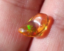 1.97 Carats. FreeForm carved Fire Mexican Opal