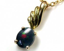 UNIQUE RED AND GREEN FLASH BLACK OPAL 18K PENDANT SCO1378
