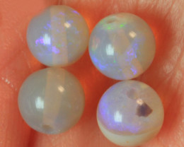 PARCEL OF SOLID CRYSTAL OPAL ROUND BEADS 4.0ct