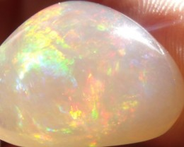 14.67 Cts. carved Fire Mexican Opal contra luz variety