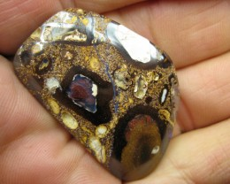 C/O.65.00cts,DRILLED CONGLOMERATE PATTERN OPAL.