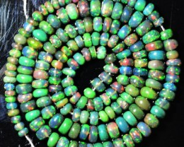 54+ Cts Smoked Ethiopian Multi Color Play Black Opal Beads NR
