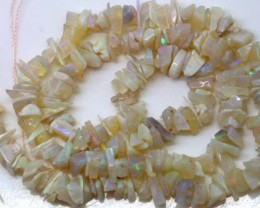 72.10 CTS WHITE OPAL STRAND LO-3885