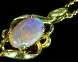 Black Opal set in 18k Gold Pendant  SB640