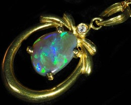 Black Opal set in 18k Gold Pendant  SB645