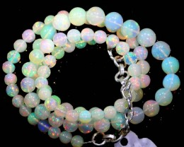 57.95CTS ROUND OPAL BEAD STRAND FOB-1073